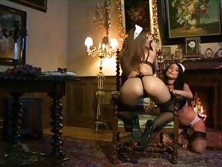 Two extremely sexy lesbian maids playing with dildos