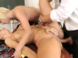 Hot golden-haired licks brunette twat as she gets ass fucked