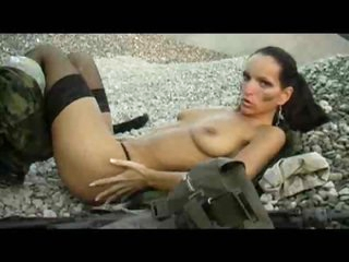Military girl masturbates her pussy outdoors