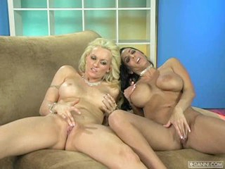 Breasty pecker tease Monica Mayhem plays with a girlfriend on the couch