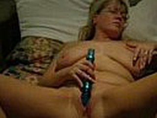 Good quality video and audio.  This mature blonde chick has her legs spread wide and a dildo stuck in her pussy.  She masturbates to orgasm.