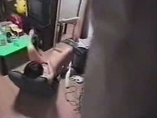 Voyeur dude films a dark-haired girl masturbating in the basement of the house, he even puts this video online by himself so everyone can see the catch he made.