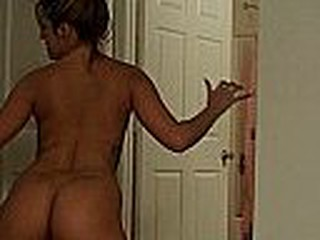 Sexy young girl with tanned ass and smal tattoo on her side shakes her sexy butt in front of the camera and lets you watch it bounce and jiggle.