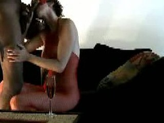 Interracial amateur couple record their own private homemade porn movie. Drinking champagne and sucking cock followed by this big black cock fucking her white awesome perky tits.