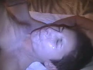 Dissipated young girl gets her pretty face covered with loads of hot cum after giving great blowjob to her boyfriend.