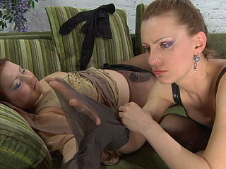 Sleepy pantyhosed chick eagerly awakes for lesbo making out on the sofa
