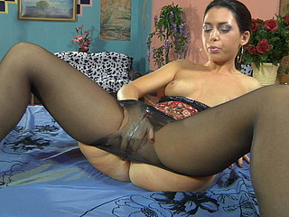 Horny dark brown clad in fine black tights getting bawdy with her jelly toy