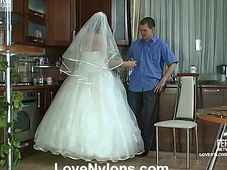 Voluptuous bride in glossy white nylons getting her beaver worked hard