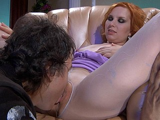 Sexy redhead gets her sleek pantyhosed legs worshipped previous to hard bonking