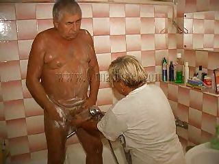 The old fart is taking a shower when his woman comes to help him wash. They may be old but they still have some passion for each other and soon a simple shower turns into a shower fuck! The granny takes off her clothes and joins him and he starts rubbing and soaping those saggy tits and then rub her pussy.
