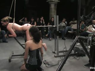 Delilah Strong is a blonde milf with small natural tits who enjoys being machine fucked in front of people. The brunette domina with huge tits makes sure she gets what she had been waiting for. The gorgeous girl tied up in ropes loves when people are watching her pussy getting roughly penetrated.