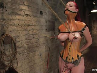 She was a very bad milf, she dominated and fucked a lot of girls and now it's time for her to be disciplined. Her pussy is starting to get really wet because the brunette mistress tied her, added clamps on her nipples and pulled them hard. She is immobilized and now has to suffer until she will become an obedient slut.