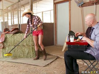 Brandy Aniston makes Johnny a sandwich before getting back to work cleaning out the stalls. He's trying to learn, but he's a city boy. Instead he goes for what he does know: big tits, namely hers. He gets her on a haystack and licks and sucks them, then goes for that sweet pussy.