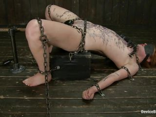 Metal clamps were added on her fragile tits and her thighs are tied with chains keeping this bitch on the sex machine. A vibrator is almost inserted in her pink vagina and her body is covered with wax. But still, somehow this is barely enough for Claire, she needs a harder punishment and perhaps she's gonna get it