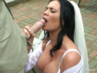 This busty bride takes a hard big cock in her mouth, sucking it with pleasure and rubbing it like a pro. Those big round boobs are asking for a huge load on them and she is helping this guy to cum on them by taking it between her breasts and then in her shaved vagina from behind. Watch the way she screams with pleasure, will she receive hot jizz on that hot booty?