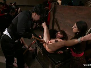 Trapped in a bondage device with her legs spread wide and her head secured, Jiz Lee is licking the cunt of a smoking hot brunette and get's drilled in her wet pussy by a dildo that is handled by the girls standing in line to have fun with her bound body. These bitches are humiliating her and surely won't stop soon.
