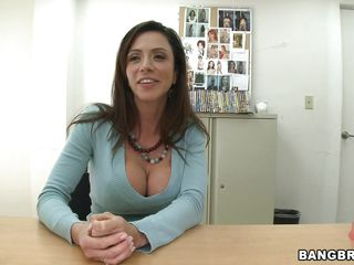 Ariella looks so fine and innocent, you may say that she's a beautiful angel and that blue blouse makes her pretty face look even prettier. Don't let the appearance fool you because under that blouse the milf has a pair of devilish big boobs and her cunt begs for a cock. She's as pretty as she is slutty!