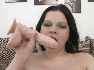 Watch those huge boobs, she really likes to play with them, putting that big dildo between those melons and imagine that it's a real dick. She's full with lust and wants to fuck as she licks the sex toy and then inserts it in her tight shaved vagina. This chubby whore needs some real cock and a huge load of semen, does she deserve it?