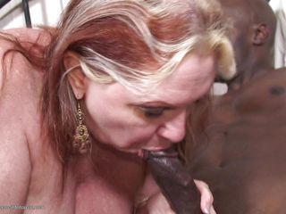 Tamara Tesla is 58 years old and she just loves black cocks. As soon as she put her dresses off she is showing her real talent by giving the hard dick black guy with a pleasing mouthful blowjob. In return she gets to ride that huge dick and fills her large vagina with it.