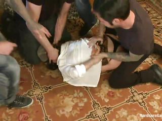 Stupid whore Mia has a pantyhose on her face and is prepared to be gang banged by five strong men. They spank their ass and big tits and start to fuck her cunt. When that big hard cocks are inside her, she likes it so much. Watch that hard nipples dancing on her tits, while she is being fucked on the floor!