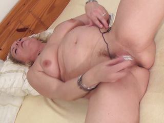 Eva is a tattooed mature that had a lot of cock and semen in her cunt. She's hard to pleased and masturbates with that sex toy before I give her some help using a bigger toy. She's almost ready for cock but why hurry, let's enjoy how the slut is in ecstasy and then maybe fill her up with a big hard dick!