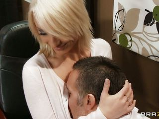 She seduces her boss by showing her boobs, hungry boss is astonished by her juicy boobs, immediately starts kissing her and undress her for full exposure of her sexy body. Sucked her breasts groped it from behind while sitting on office desk. She demands to suck his dick.