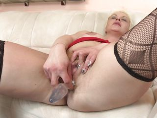 Debra is a mature blonde that likes fucking. When she's not in the companionship of a guy or more this fucking whore takes care of herself using that sex toy. She lays on the couch, relaxes and spread those sexy thighs as wide as she can before inserting the sex toy in her cunt. Yeah Debra, you know what we like to see