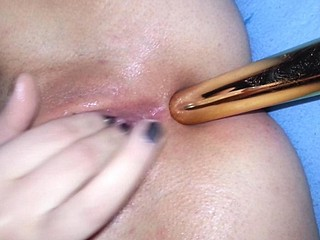 My girl getting an anal stimulation with a dildo