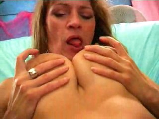 Mature can suck her own sexy teats