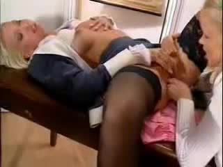 Young blondes in classroom have sex
